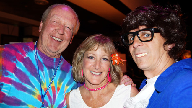 "Jim and Jill Davis (""Garfield"" creator) and Mark (as Austin Powers) at NCS 60s party"