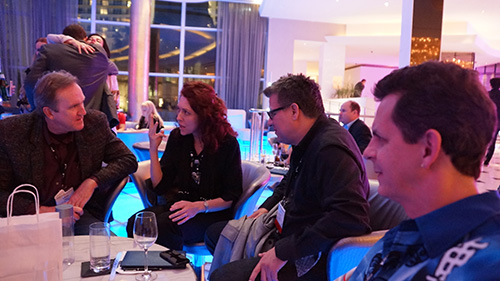 NATPE_2013_Mark_Wayne_and_Angela_with_Lionsgate_producer_at_bar