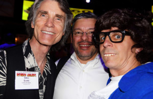 Mark Simon as Austin Powers on the right with Greg Evans of Luann on the left and Hector Cantu of Baldo in the center, at the Reuben weekend 60's costume party.