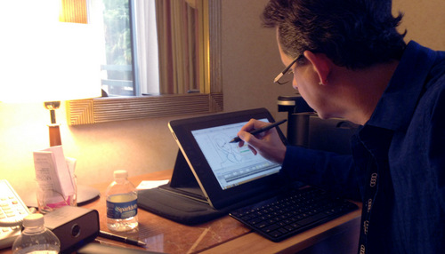 Mark using the Cintiq Companion to storyboard in his hotel on location