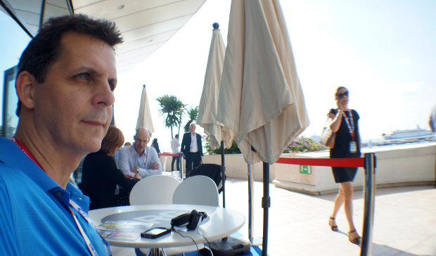 Mark waiting for a meeting at MIPCOM as he looks over the French Riviera. He has a trick to get past the Hollywood Gate Keepers.