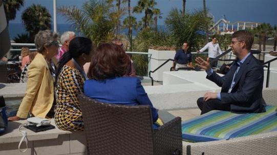 Chris Linn, sitting right, President of truTV