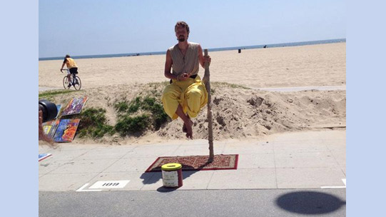 panhandler-practicing-his-unique-type-of-yoga-on-the-boardwalk-outside-the-hotel.